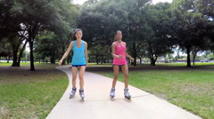 Young active multi ethnic American girls rollerblading outdoor - stock footage