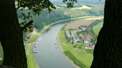 The town of Oberrathen along the Elbe River seen from the Bastei cliffs - stock footage