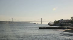 View of Tage river and 25 de abril bridge Stock Footage