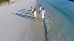 Aerial drone of Caucasian family outdoor on a luxury beach Stock Footage