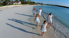 Aerial drone Caucasian family walking together on beach holiday Stock Footage