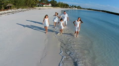Aerial drone Caucasian family together on beach holiday - stock footage