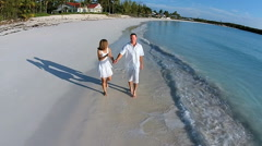 Aerial drone of a Caucasian couple enjoying luxury vacation Stock Footage