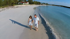 Aerial drone of a happy Caucasian couple on an island vacation Stock Footage