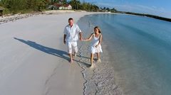 Aerial drone of a Caucasian couple at a beach resort Stock Footage