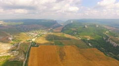 Bird's Eye View Of Hilly Locality And Harvest Field Stock Footage