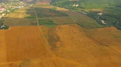 Aerial View Of Hilly Locality And Agricultural Fields Stock Footage