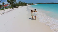 Aerial view African American Asian Chinese girls enjoying leisure on beach Stock Footage