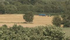 Tractor tows trailer full of wheat. Stock Footage