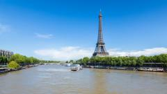 River Seine with the Eiffel Tower in the distance, Paris, France - Time lapse - stock footage