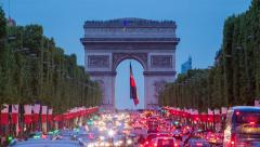View down the Champs Elysees to the Arc de Triomphe, illuminated at dusk, Paris, Stock Footage