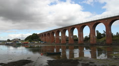 Train crossing Brick Viaduct Montrose Scotland Stock Footage