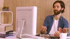 Hipster worker throwing ball at desk Stock Footage