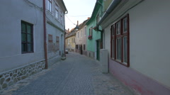 Narrow street with green and pink houses, Sibiu Stock Footage