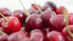 Sour cherries   arranged on white background 4K 3840X2160 UltraHD tilt  foota Stock Footage
