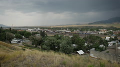 Small Western Town from Above with Storm Clouds Stock Footage