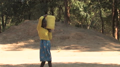 Stock Video Footage of Carrying the Water Jug in Kitwe, Zambia