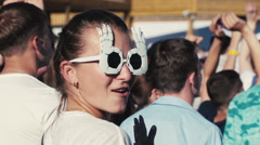Girl in funny sunglasses dancing and kissing man Stock Footage