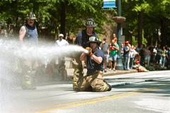 Firemen Shoot Water At Target In Atlanta Muster Competition Stock Photos