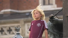 Boy standing near the Battle of Grunwald monument in Krakow Stock Footage