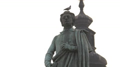 Bird standing on Adam Mickiewicz Monument, Krakow Stock Footage