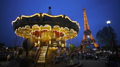 Carousel below the Eiffel Tower at twilight, Paris France - stock footage