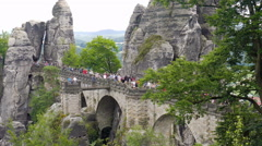 Bastei cliffs and tourists on a bridge. Saxon Switzerland National Park, Germany Stock Footage