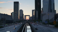Paris road leading towards La Grand Arche and modern office buildings at La Stock Footage