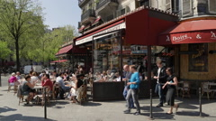 Cafe and street scene in Montmartre, Paris, France, Europe Stock Footage
