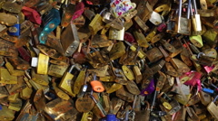 Lover's padlocks or love locks which adorn many bridges in Paris, France - stock footage
