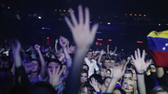 Crowd raise hands up and dancing. Slow motion Stock Footage