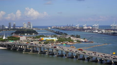 Stock Video Footage of Elevated view over the Mac Arthur Causeway and the Port of Miami, the Cruise