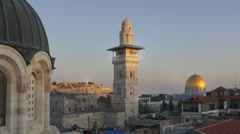 Panning shot of Time lapse of sunset over Jerusalem rooftops, including Dome of - stock footage
