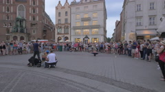 Man spinning on head in the city center of Krakow Stock Footage