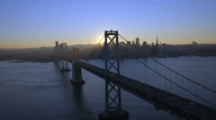 Aerial sunset view Oakland Bay Bridge San Francisco USA Stock Footage