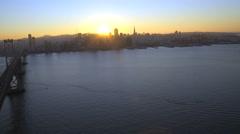 Aerial sunset view Oakland Bay Bridge San Francisco USA Stock Footage
