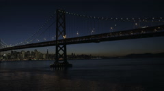 Aerial illuminated view Oakland Bay Bridge San Francisco USA - stock footage