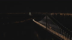 Aerial illuminated Oakland Bay Bridge San Francisco USA - stock footage