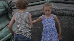 Children playing at the Adam Mickiewicz Monument, Krakow Stock Footage