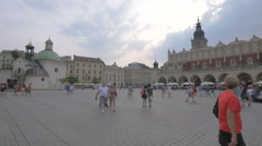 The Church of St. Wojciech and The Cloth Hall in Krakow Stock Footage