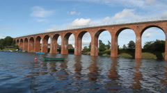 Brick Viaduct reflected in Montrose Basin Scotland Stock Footage