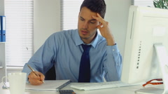 Businessman stressed out at work - stock footage