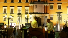 Nightlife in Warsaw People dine in restaurant in front of the Royal Castle Stock Footage