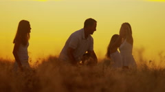 Carefree Caucasian Family Enjoying Vacation Together Outdoors Sunset Silhouette Stock Footage