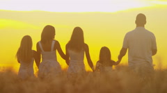 Carefree Caucasian Family Enjoying Vacation Together Outdoors Sunrise Silhouette Stock Footage