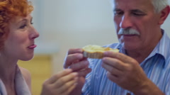 An older couple eating bread with honey Stock Footage