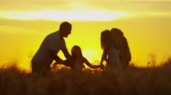Heterosexual Parents Daughters Sunset Silhouette Outdoors Loving Casual Leisure - stock footage