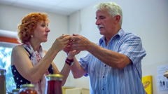 Older couple eating bread with delicious organic honey Stock Footage