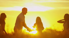 Sunrise Caucasian Family Team Sibling Sisters Parents Affection Freedom Outdoor Stock Footage