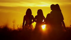 Stock Video Footage of Sunset Caucasian Family Team Sibling Sisters Parents Affection Freedom Outdoor